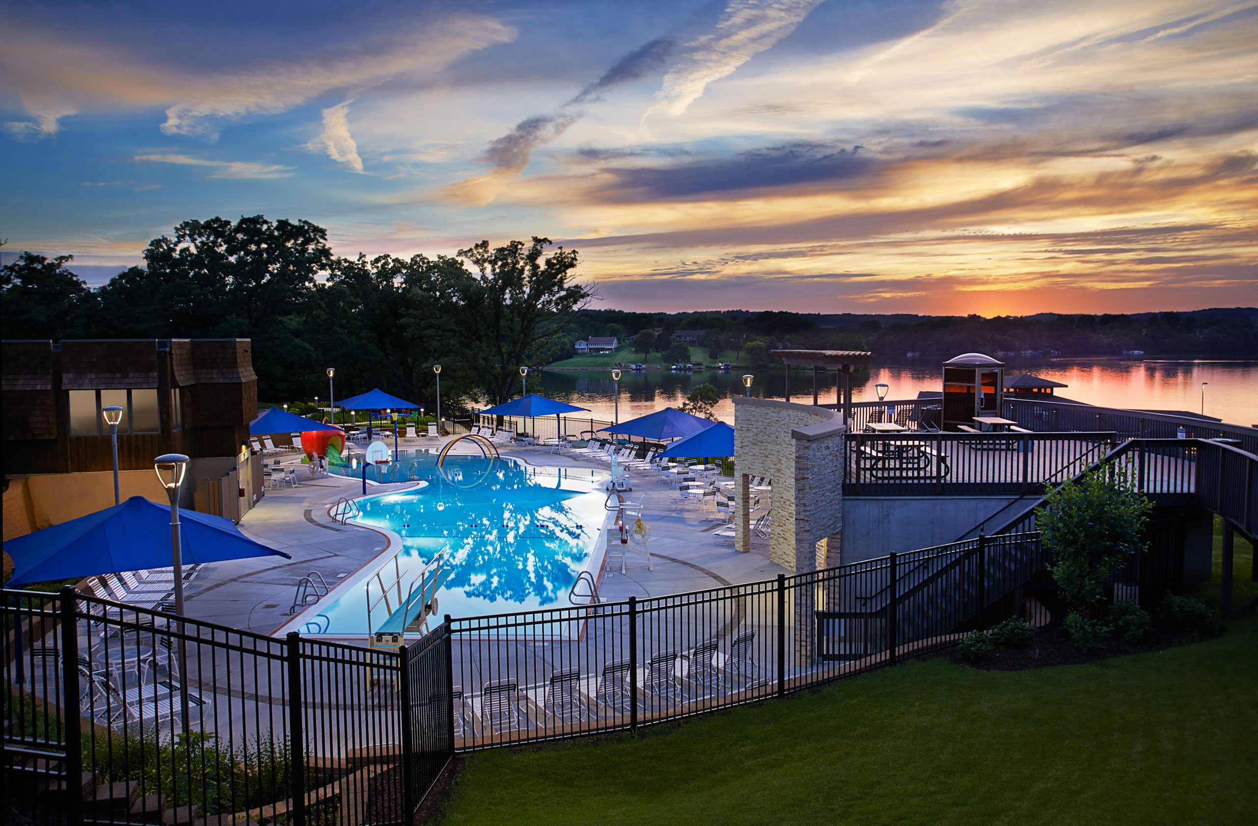 Exterior dusk swimming pool photograph